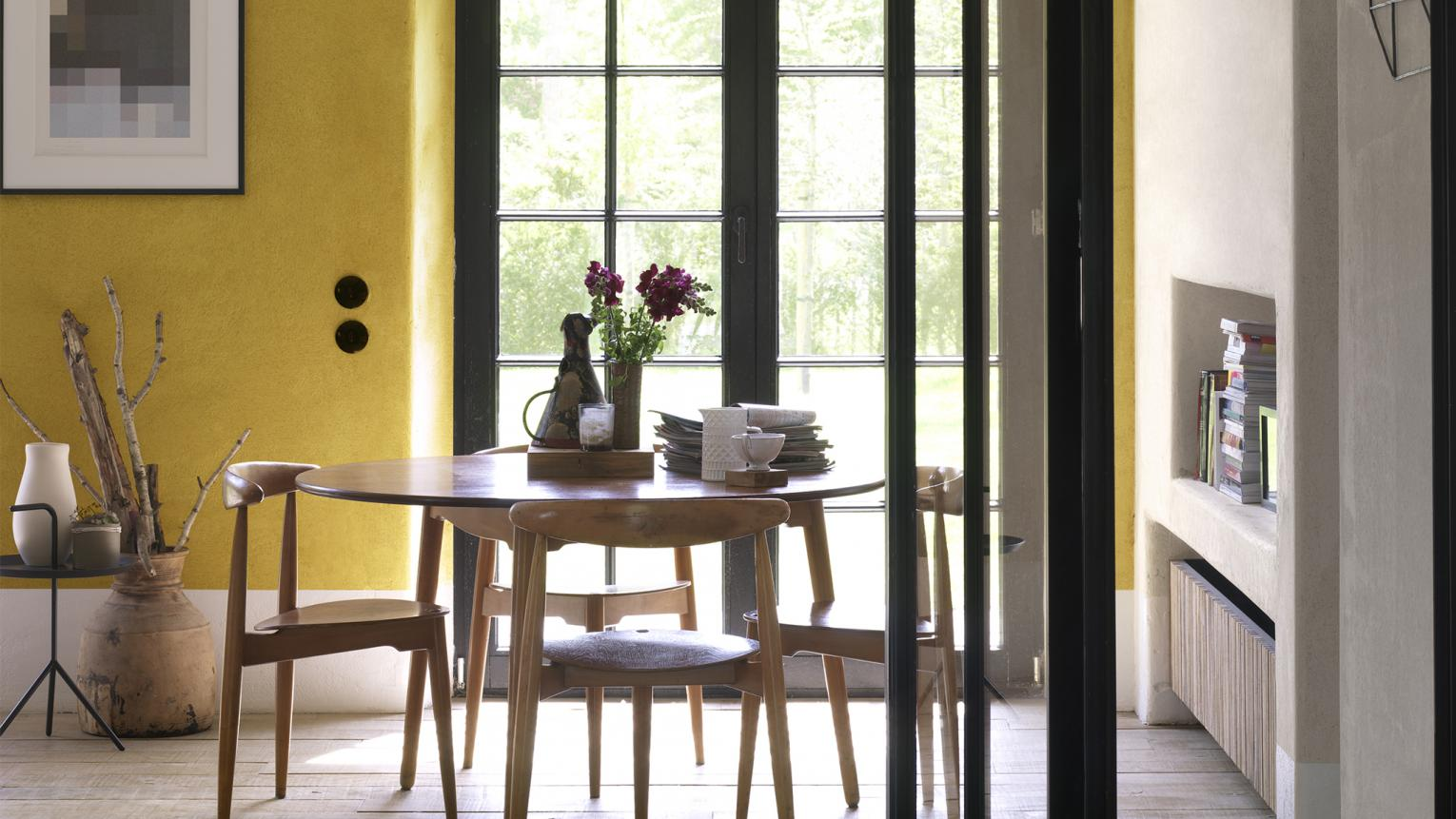 Mix neutral shades with one bright colour to create a multifunctional dining room.