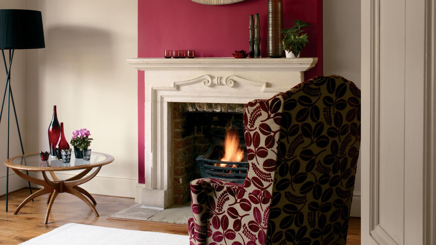 Make an interior design statement in the living room with a striking feature panel painted in garnet red.