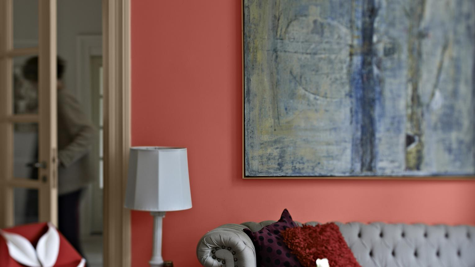 For a passionate living room decor, why not try painting in Dulux bold red. This stylish living space takes its inspiration from Spanish-style interiors.