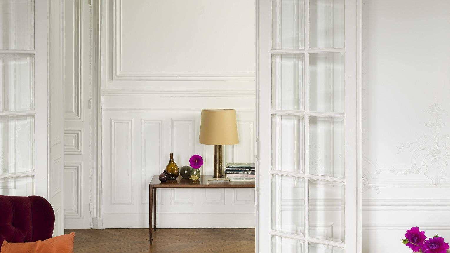 Create an elegant French decor that emulates Parisian style by layering different shades of white paint.