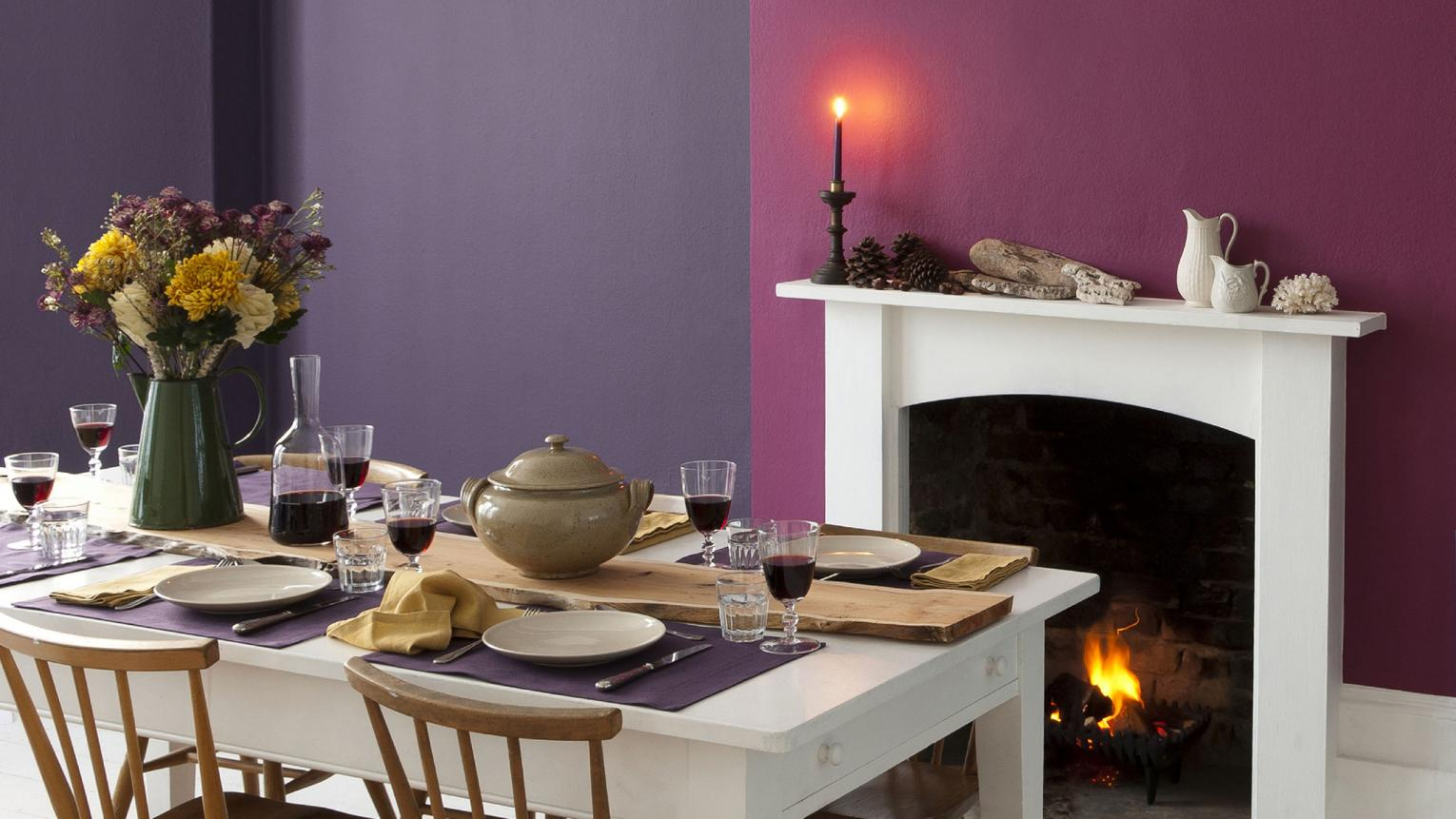 Warm paint colours create an intimate dining room