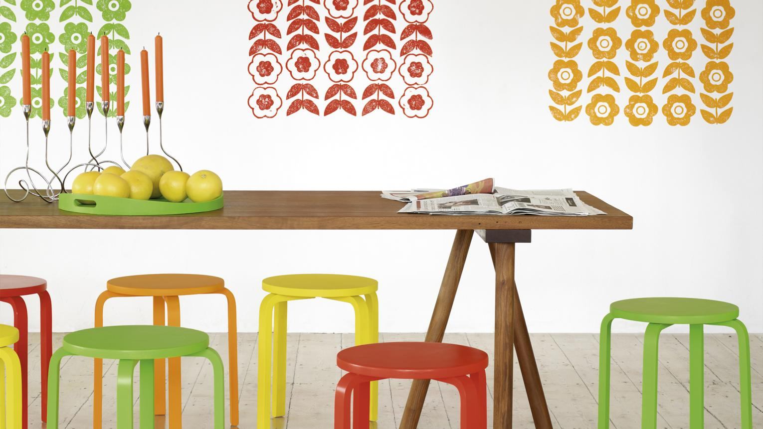 Paint green, red and orange patterns to liven up neutral dining room walls.