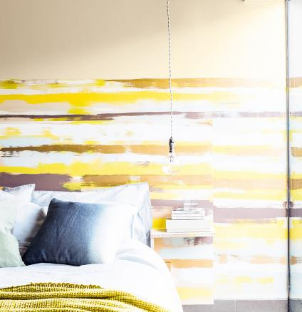 Express your creativity with this striking striped feature wall. This easy DIY project is as simple as layering contrasting colour combinations for a bold, blurred paint effect.