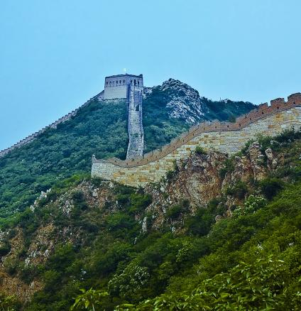 Great Wall of China looks magnificent against a blue and green landscape.