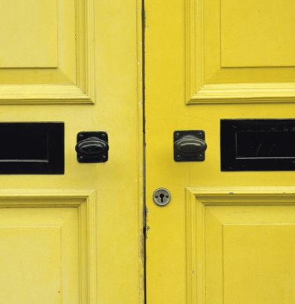Buttercup yellow front doors.