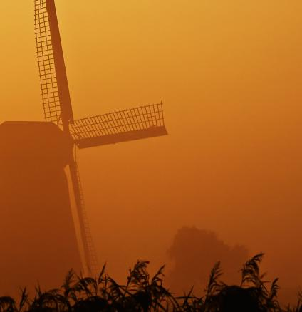 Dutch windmill in orange sunset